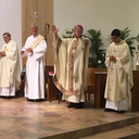 Fr. Tony Hughes, Deacon Tim O'Callaghan, Bishop George Leo Thomas and Fr. Toan Lai.